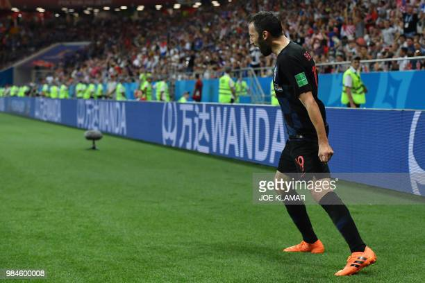 Croatia's midfielder Milan Badelj celebrates after scoring the opening goal during the Russia 2018 World Cup Group D football match between Iceland...