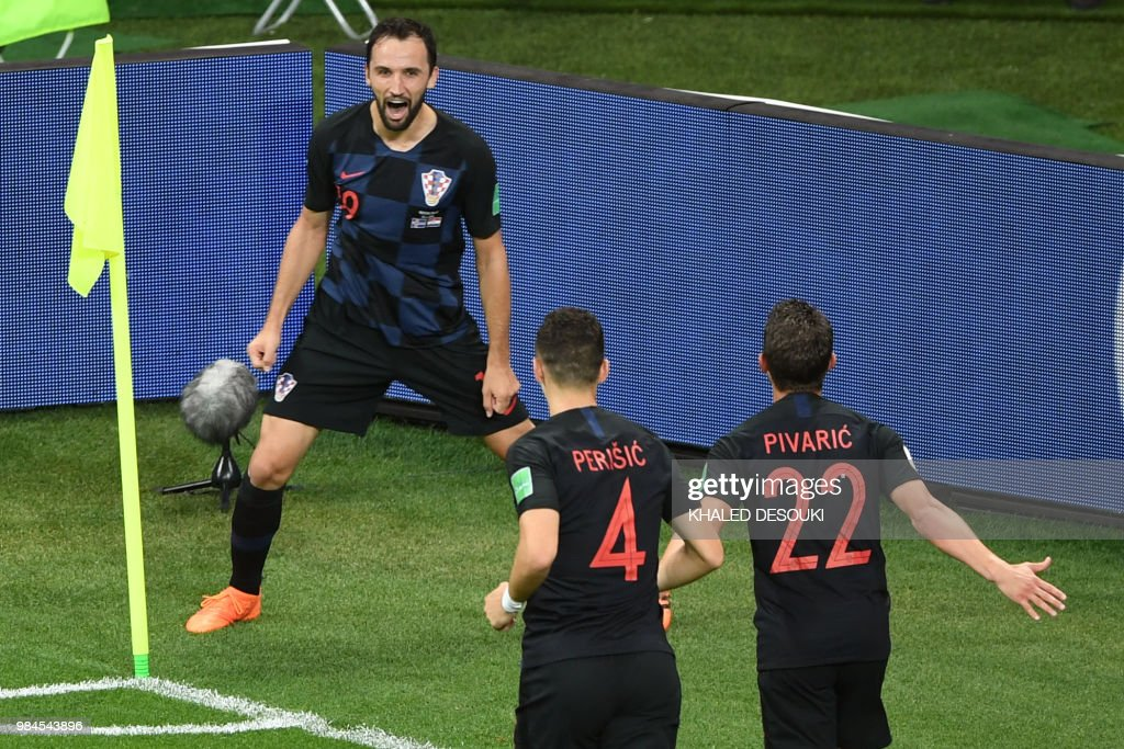 TOPSHOT - Croatia's midfielder Milan Badelj (back) celebrates with teammates after scoring a goal during the Russia 2018 World Cup Group D football match between Iceland and Croatia at the Rostov Arena in Rostov-On-Don on June 26, 2018. (Photo by Khaled DESOUKI / AFP) / RESTRICTED