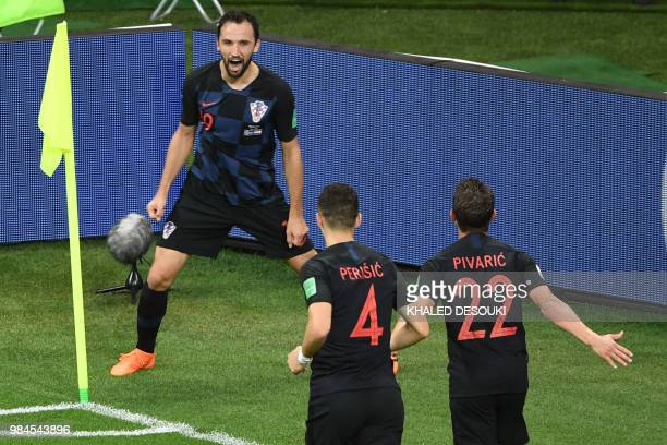 TOPSHOT Croatia's midfielder Milan Badelj celebrates with teammates after scoring a goal during the Russia 2018 World Cup Group D football match...