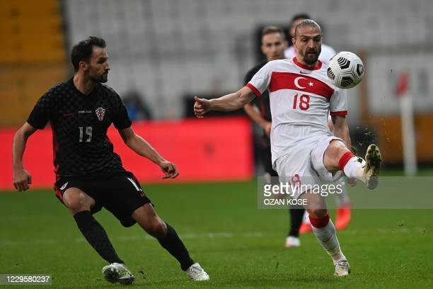 Croatia's midfielder Milan Badelj looks at Turkey's defender Caner Erkin controlling the ball during the friendly football match between Turkey and...