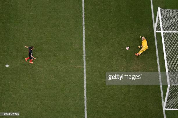 Croatia's midfielder Milan Badelj misses his penalty during the penalty shootout of the Russia 2018 World Cup round of 16 football match between...