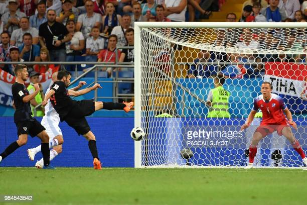 TOPSHOT Croatia's midfielder Milan Badelj scores the opening goal during the Russia 2018 World Cup Group D football match between Iceland and Croatia...