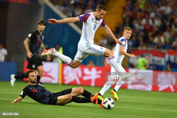 Croatia's midfielder Milan Badelj vies with Iceland's midfielder Gylfi Sigurdsson during the Russia 2018 World Cup Group D football match between...