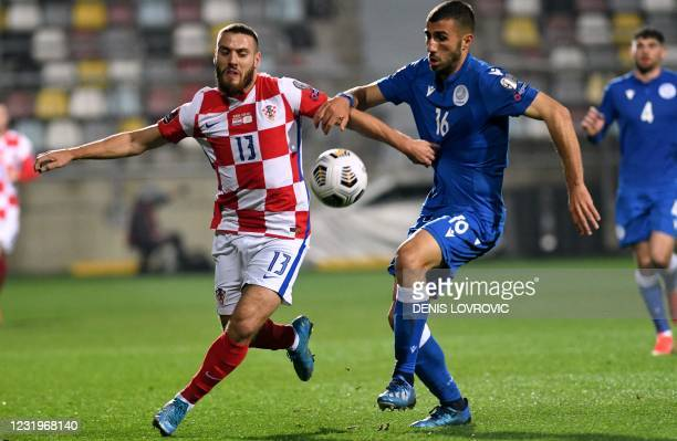 Croatia's midfielder Nikola Vlasic fights fo rthe ball with Cyprus' defender Costas Soteriou during the FIFA World Cup Qatar 2022 qualification Group...