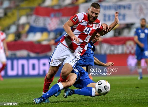 Croatia's midfielder Nikola Vlasic fights fo rthe ball with Cyprus' defender Kostas Laifis during the FIFA World Cup Qatar 2022 qualification Group H...