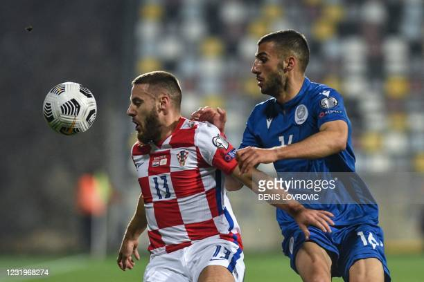 Croatia's midfielder Nikola Vlasic fights for the ball with Cyprus' defender Costas Soteriou during the FIFA World Cup Qatar 2022 qualification Group...