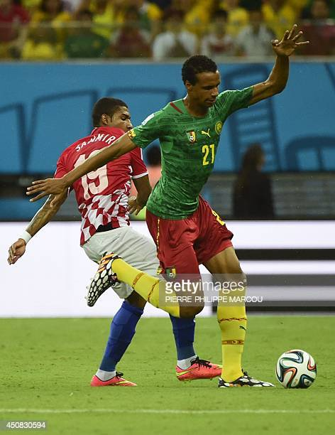 Croatia's midfielder Sammir vies for the ball with Cameroon's midfielder Joel Matip during a Group A football match between Cameroon and Croatia in...