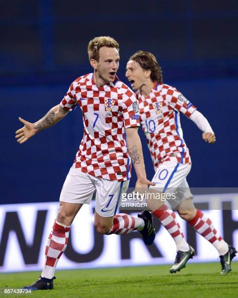 Croatia's midfielders Luka Modric and Ivan Rakitic celebrate after scoring a goal during the FIFA World Cup 2018 qualification football match between...