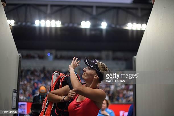 Croatia's Mirjana LucicBaroni waves to fans following her victory against Poland's Agnieszka Radwanska during their women's singles second round...