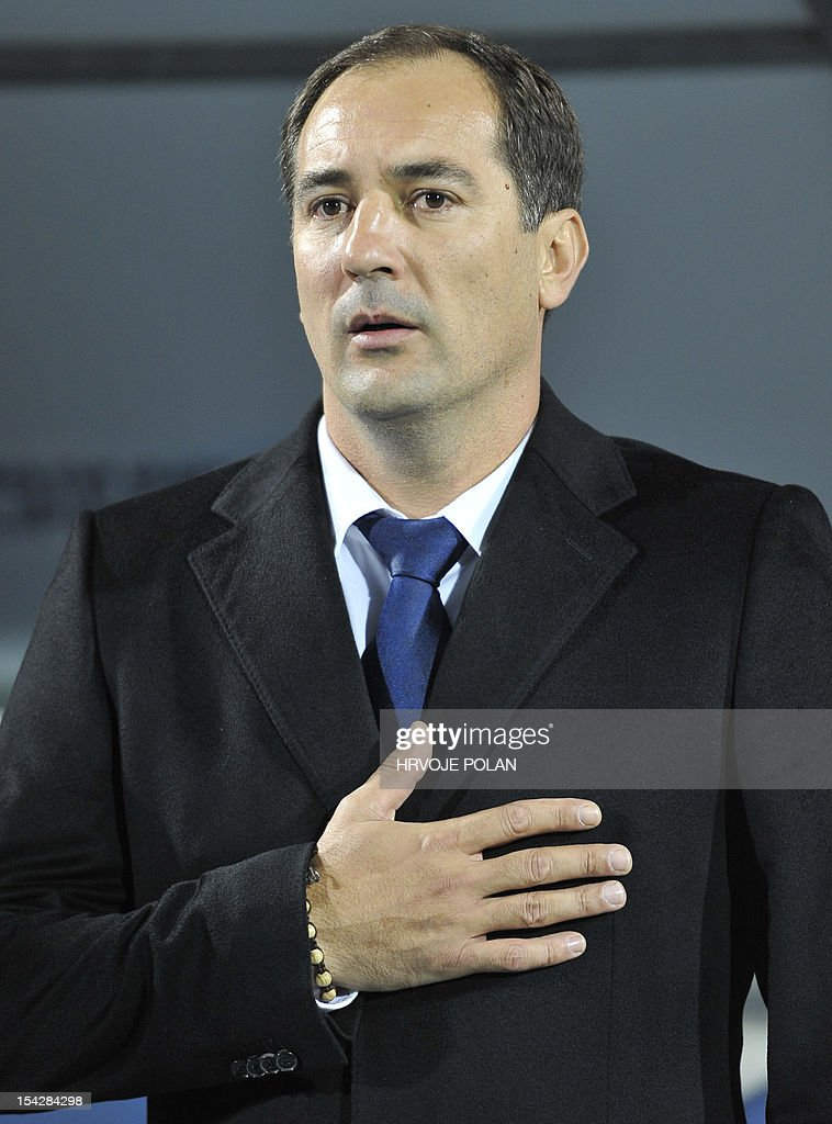 Croatia's national football team head coach Igor Stimac listens to the national anthem before their FIFA 2014 group A World Cup qualifier football match against Wales in Osijek, some 350 kilometres from Zagreb, on October 16, 2012. AFP PHOTO/Hrvoje POLAN