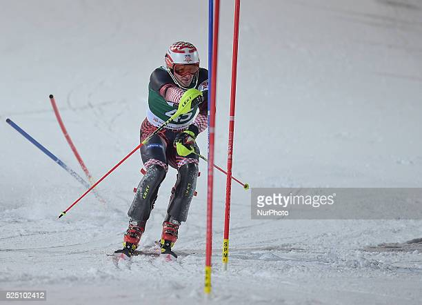 Croatia's Natko Zrncic-Dim, races down the famous Hahnenkamm course during the men's Alpine Combined - Slalom, at the FIS SKI World Cup in...