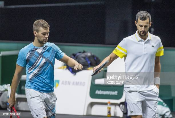 Croatia's Nicola Mektic and Mate Pavic are seen during their Rotterdam ATP tournament men's double semi-final tennis match against France's Jeremy...
