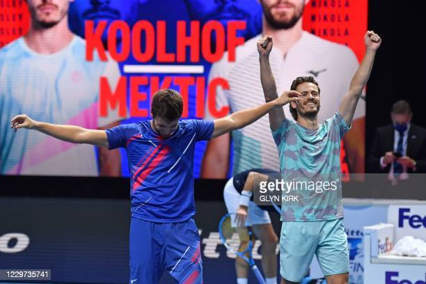 Croatia's Nikola Mektic reacts with his playing partner Netherlands' Wesley Koolhof after they beat Austria's Jurgen Melzer and France's Edouard...