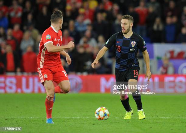 Croatia's Nikola Vlasic under pressure from Wales Connor Roberts during the UEFA Euro 2020 qualifier between Wales and Croatia at Cardiff City...