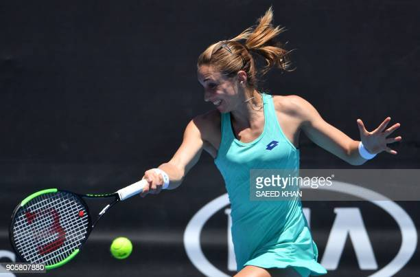 Croatia's Petra Martic hits a return against Romania's IrinaCamelia Begu during their women's singles second round match on day three of the...