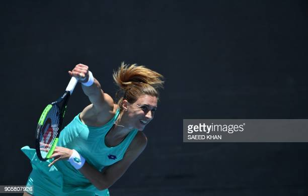 Croatia's Petra Martic serves against Romania's IrinaCamelia Begu during their women's singles second round match on day three of the Australian Open...