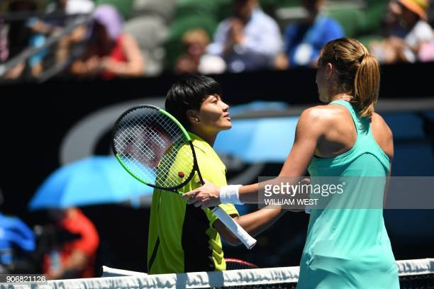 Croatia's Petra Martic shakes hands with Thailand's Luksika Kumkhum after their women's singles third round match on day five of the Australian Open...