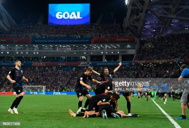 TOPSHOT Croatia's players celebrate a goal during the extra time of the Russia 2018 World Cup quarterfinal football match between Russia and Croatia...