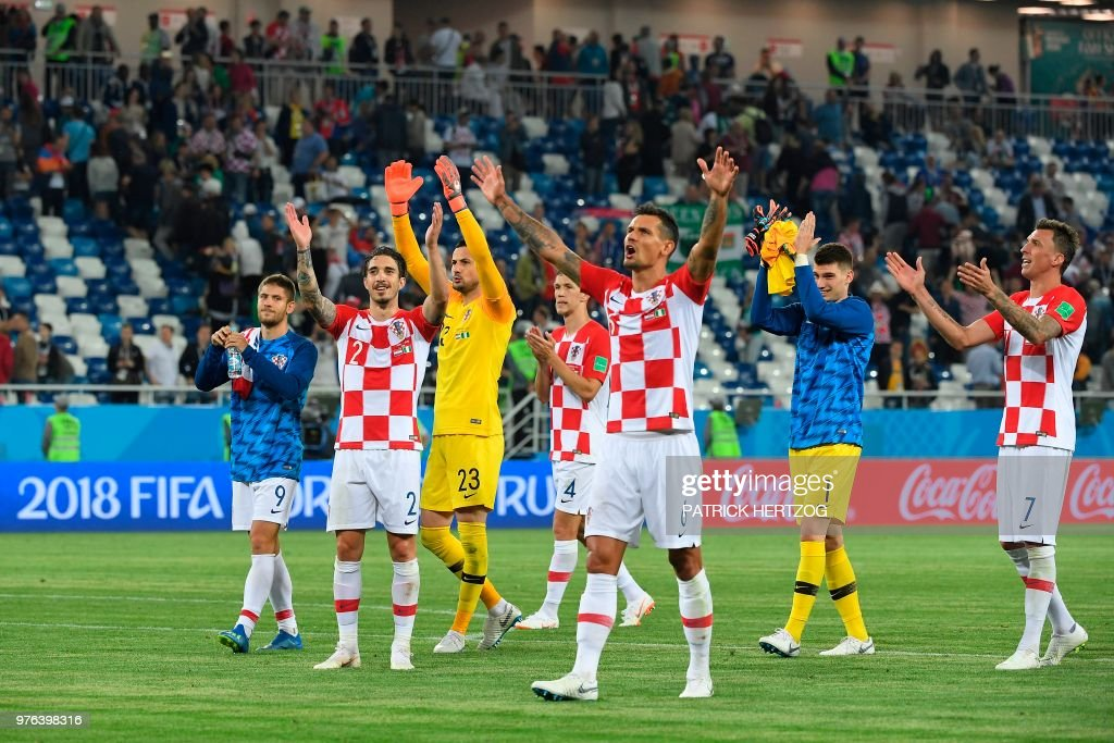 Croatia's players celebrate after during the Russia 2018 World Cup Group D football match between Croatia and Nigeria at the Kaliningrad Stadium in Kaliningrad on June 16, 2018. (Photo by Patrick HERTZOG / AFP) / RESTRICTED