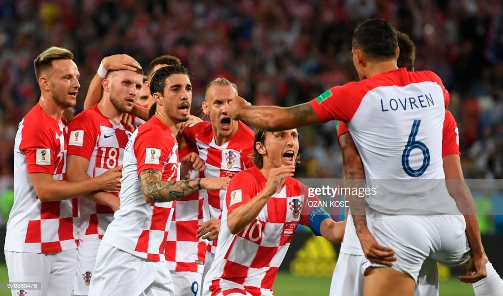 TOPSHOT - Croatia's players celebrate after Nigeria's midfielder Oghenekaro Etebo scored an own goal during the Russia 2018 World Cup Group D football match between Croatia and Nigeria at the Kaliningrad Stadium in Kaliningrad on June 16, 2018. (Photo by OZAN KOSE / AFP) / RESTRICTED