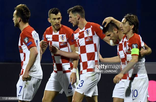 Croatia's players celebrate after scoring during the Euro 2020 qualification football match between Croatia and Azerbaijan at Maksimir stadium in...