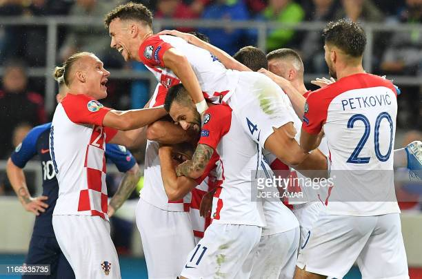 Croatia's players celebrate after scoring during the UEFA Euro 2020 qualification football match between Slovakia and Croatia in Trnava Slovakia on...