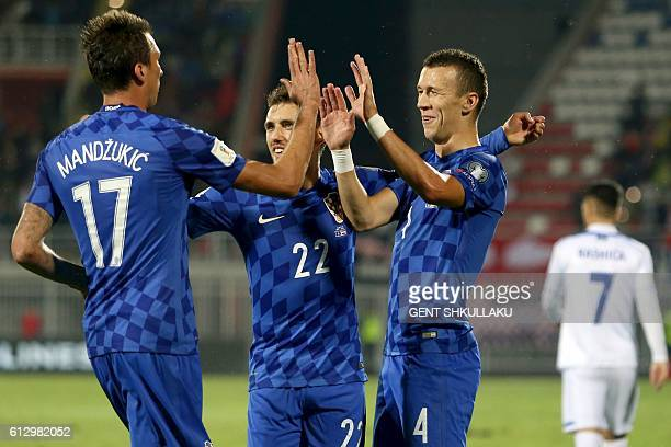 Croatia's players celebrate after scoring during the World Cup 2018 qualifier football match Kosovo vs Croatia in Loro Borici stadium in the city of...