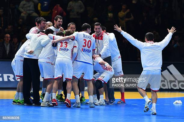 TOPSHOT Croatia's players celebrate after winning the 25th IHF Men's World Championship 2017 quarter final handball match Spain vs Croatia on January...