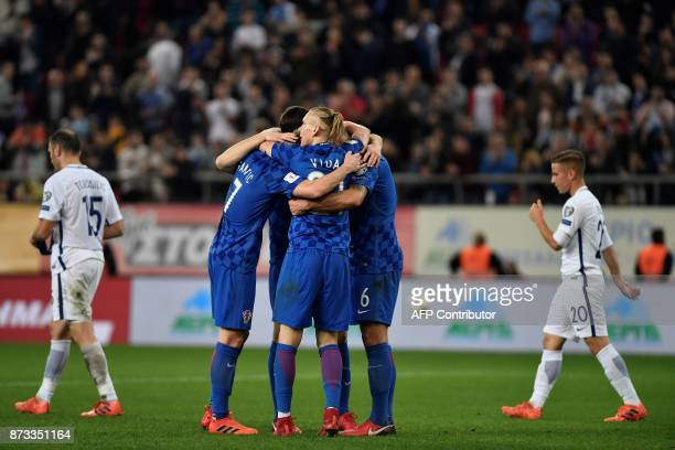 Croatia's players celebrate after winning the World Cup 2018 playoff football match Greece vs Croatia on November 12 2017 in Piraeus / AFP PHOTO /...