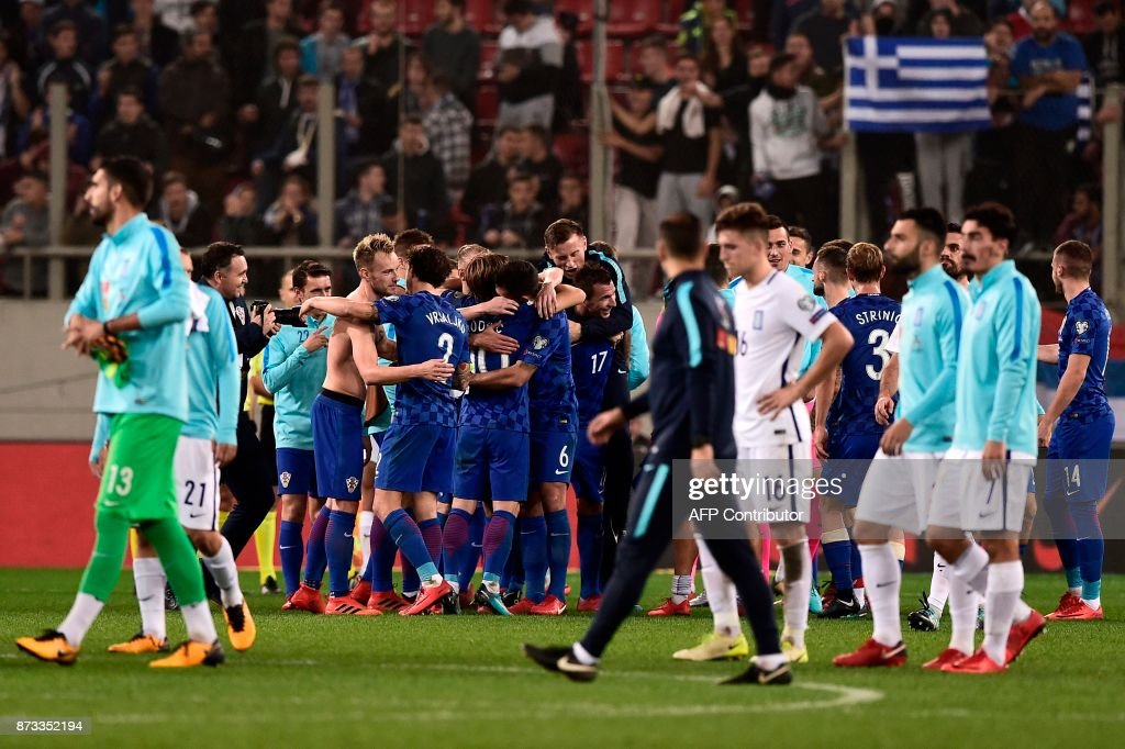 Croatia's players celebrate after winning the World Cup 2018 play-off football match Greece vs Croatia, on November 12, 2017 in Piraeus. /