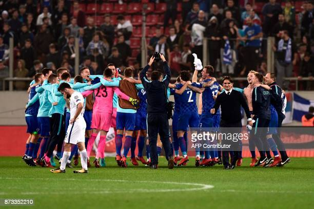 Croatia's players celebrate after winning the World Cup 2018 playoff football match Greece vs Croatia on November 12 2017 in Piraeus / AFP PHOTO /...