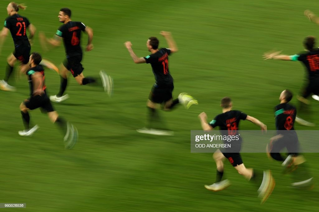 TOPSHOT - Croatia's players celebrate at the end of the penalty shootouts of the Russia 2018 World Cup quarter-final football match between Russia and Croatia at the Fisht Stadium in Sochi on July 7, 2018. (Photo by Odd ANDERSEN / AFP) / RESTRICTED