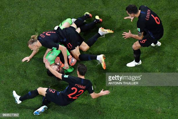 Croatia's players celebrate at the end of the penalty shootouts of the Russia 2018 World Cup quarterfinal football match between Russia and Croatia...