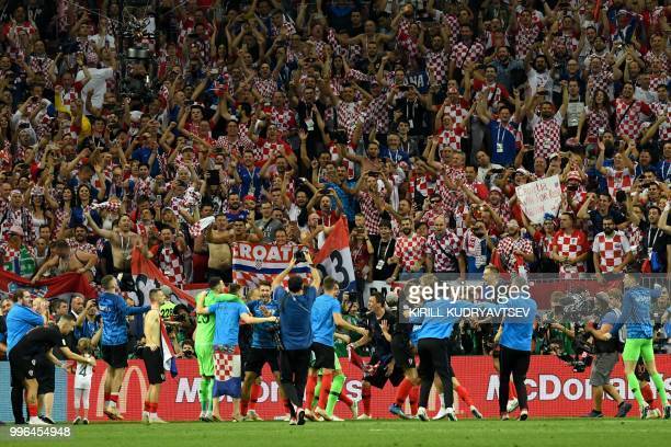 Croatia's players celebrate at the end of the Russia 2018 World Cup semi-final football match between Croatia and England at the Luzhniki Stadium in...