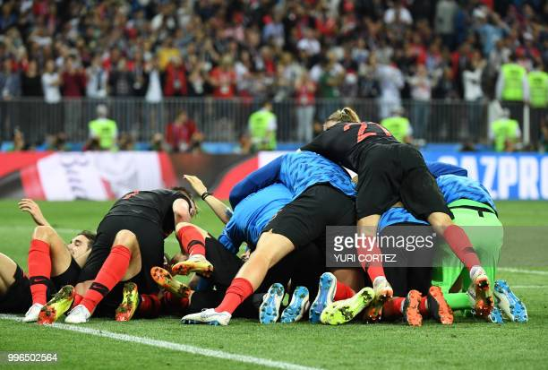 Croatia's players celebrate at the end of the Russia 2018 World Cup semifinal football match between Croatia and England at the Luzhniki Stadium in...