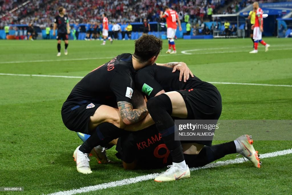 TOPSHOT - Croatia's players celebrate their equaliser during the Russia 2018 World Cup quarter-final football match between Russia and Croatia at the Fisht Stadium in Sochi on July 7, 2018. (Photo by Nelson Almeida / AFP) / RESTRICTED