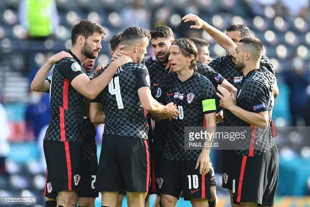 Croatia's players celebrate their equaliser during the UEFA EURO 2020 Group D football match between Croatia and Czech Republic at Hampden Park in...