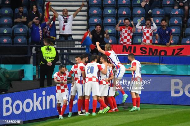 Croatia's players celebrate their second goal during the UEFA EURO 2020 Group D football match between Croatia and Scotland at Hampden Park in...
