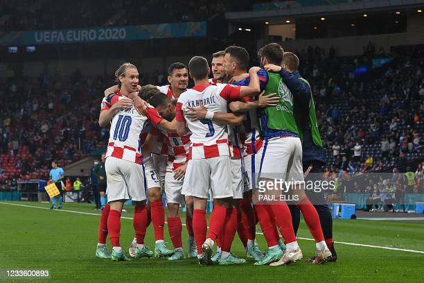 Croatia's players celebrate their third goal during the UEFA EURO 2020 Group D football match between Croatia and Scotland at Hampden Park in Glasgow...