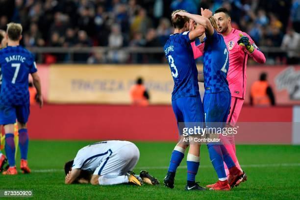 Croatia's players celebrates after winning the World Cup 2018 playoff football match Greece vs Croatia on November 12 2017 in Piraeus / AFP PHOTO /...