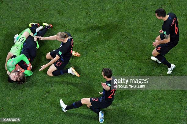 Croatia's players congratulate Croatia's goalkeeper Danijel Subasic after winning at the end of the penalty shootouts of the Russia 2018 World Cup...