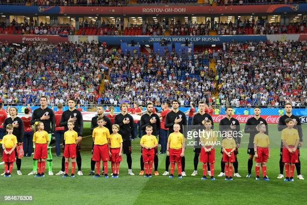 Croatia's players listen to the national anthem ahead of the Russia 2018 World Cup Group D football match between Iceland and Croatia at the Rostov...