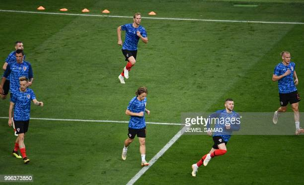 Croatia's players warm up prior to the Russia 2018 World Cup semifinal football match between Croatia and England at the Luzhniki Stadium in Moscow...