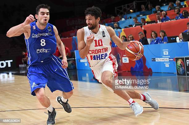 Croatia's point guard Roko Leni Ukic dribbles around Czech Republic's point guard Tomas Satoransky during the round of 16 basketball match between...