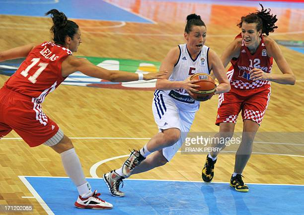 Croatia's power forward Iva Sliskovic and small forward Ana Lelas vie with Great Britain's guard Rose Anderson during the EuroBasket Women 2013...