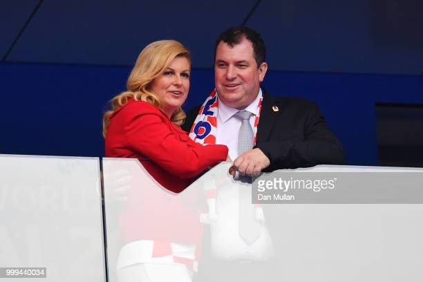 Croatia's President Kolinda GrabarKitarovic and her husband Jakov Kitarovic are seen during the 2018 FIFA World Cup Final between France and Croatia...