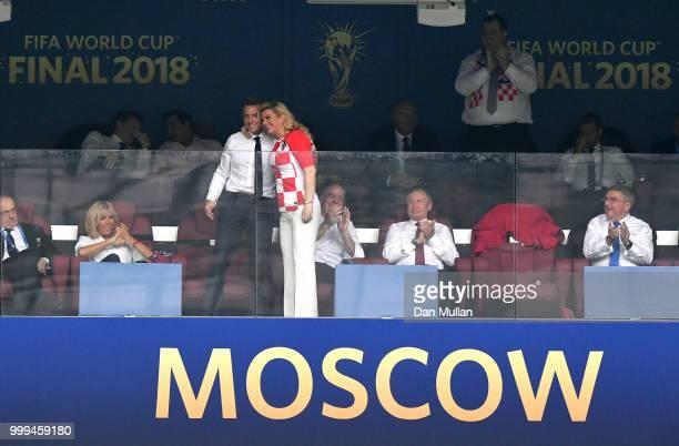 Croatia's President Kolinda GrabarKitarovic celebrates herteam's first goal with French President Emmanuel Macron during the 2018 FIFA World Cup...