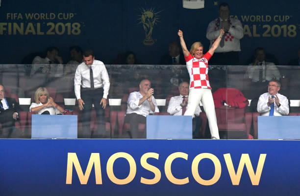 Croatia's President Kolinda Grabar-Kitarovic celebrates his team's first goal during the 2018 FIFA World Cup Final between France and Croatia at...