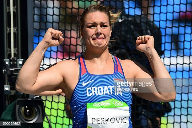 TOPSHOT Croatia's Sandra Perkovic reacts while competing in the Women's Discus Throw Final during the athletics competition at the Rio 2016 Olympic...
