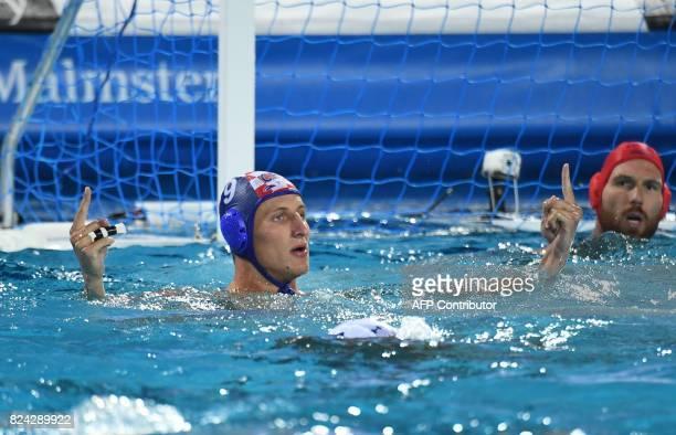 Croatia's Sandro Sukno celebrates his score against Hungary's goalkeeper Viktor Nagy in 'Hajos Alfred' swimming pool of Budapest on July 29 2017...